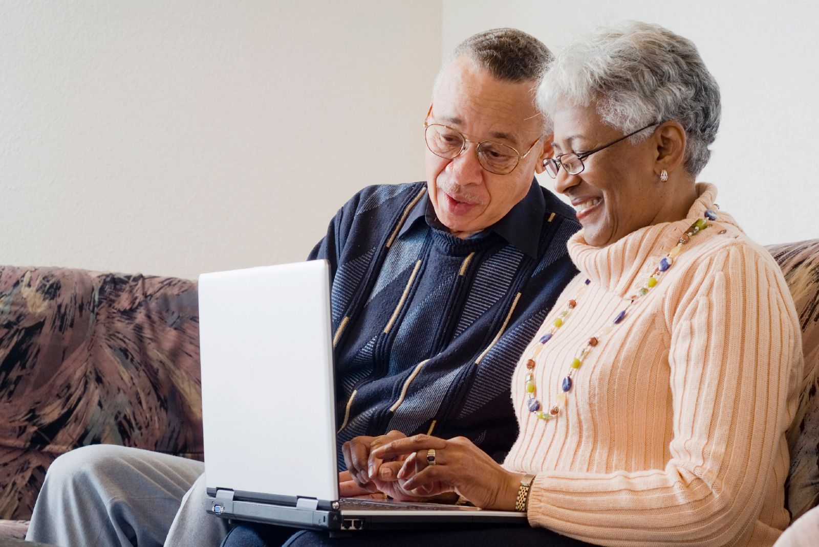 Two older adults with a computer